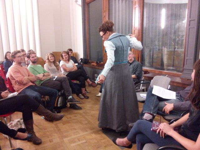 Kat Jungnickel demonstrating her cycling costume based on a design patent lodged by a woman in Bristol in 1897.